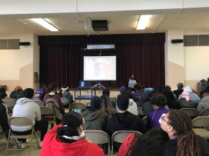 Associate Dafney Dubuisson Stokes presenting in STEMCivics Auditorium